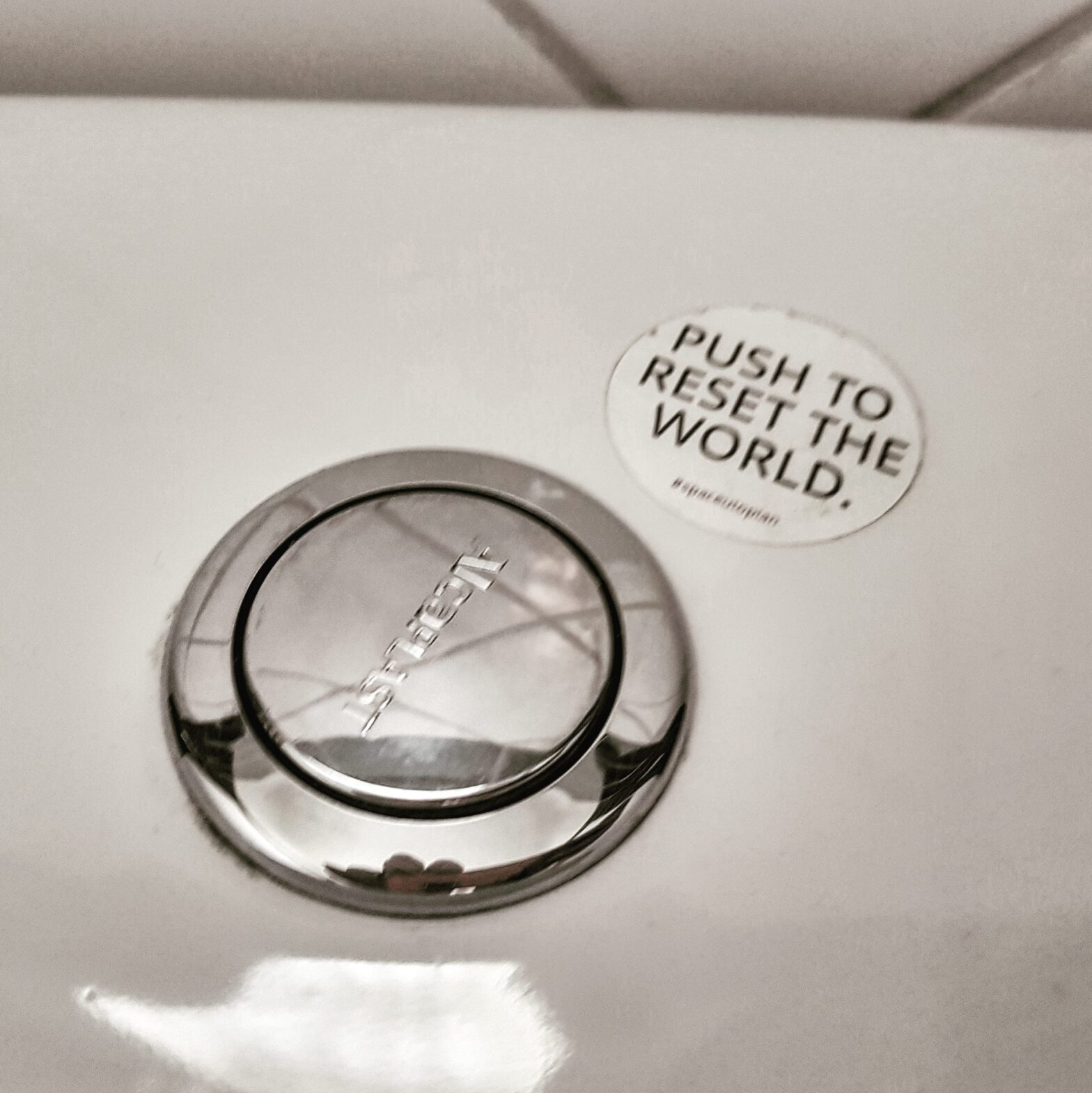 "there's no workaround for accountability - toilet flush button with sticker saying ""push to reset the world"""